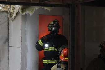 Chief Jackson instructing on how to contain a single room fire.