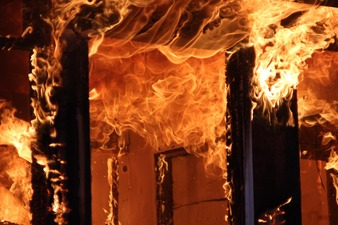 Flames lapping through a doorway.
